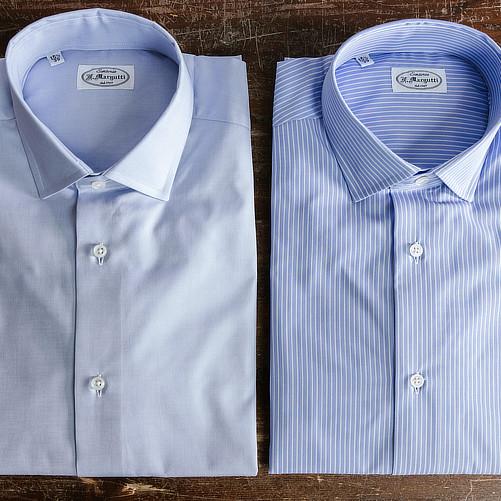 Camicie celesti su misura piegate tessuti John e David Anderson